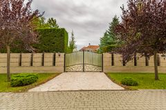 Elegant house driveway with iron fence and gate Stock Photography