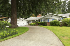 House with driveway and landscape Stock Photos