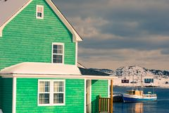 House at Durrell Harbor in Twillingate NL Canada. Traditional green wooden house at Durrell Harbour of outport fishing town of Twillingate at wintertime royalty free stock image