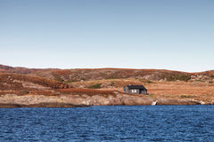 House on empty rocky coast in Norway Stock Images