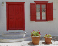 House entrance and flowerpots Royalty Free Stock Image