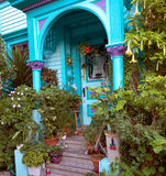 House entrance at Haight and Ashbury. Boldly decorated house entrance with many plants, painted blue green and violet. Located in San Francisco at Haight and Royalty Free Stock Photos