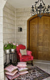 House entrance hall. Entrance hall to a house with armchair and cushions Royalty Free Stock Photo