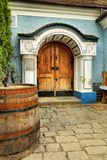 House entry and wine keg. House entry and keg with wine motive decorated Royalty Free Stock Image