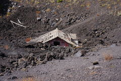 House after eruption of Etna stock photos