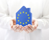 House with EU flag in hands Stock Images