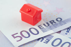 House on euro. Red plastic house on five hundred euro notes Royalty Free Stock Image