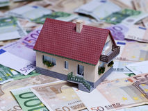 House with Euro banknotes Stock Photos