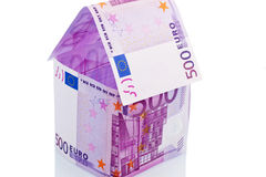 House of euro banknotes. A house built with money seem on a white background. building savings, house building and home buying Royalty Free Stock Image