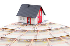 House and euro banknotes. Model house and euro banknotes over white background Royalty Free Stock Image