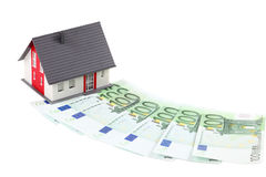 House and euro banknotes. Model house and euro banknotes over white background Royalty Free Stock Photography