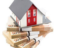 House on euro banknotes. Symbolic photograph for home purchase, financing, building society Royalty Free Stock Photos