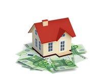 House with Euro banknotes  on white Royalty Free Stock Photos
