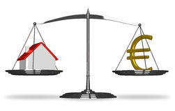 House and euro sign on scales Royalty Free Stock Photo