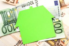 House and euros. High cost of construction or renting a house Stock Image