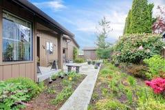 House exterior. Backyard porch and garden Royalty Free Stock Photo