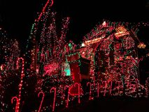 A house exterior with christmas lights decoration. A house exterior with beautiful and colorful lights decoration during christmas holiday in Torrington New royalty free stock images