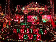 A house exterior with christmas lights decoration. A house exterior with beautiful and colorful lights decoration during christmas holiday in Torrington New stock photography