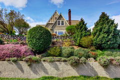 House exterior with beautiful curb appeal. House exterior with beautiful landscape on front yard Royalty Free Stock Images