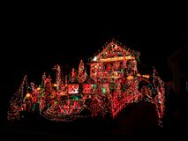 A house exterior with christmas lights decoration. A house exterior with beautiful and colorful lights decoration during christmas holiday in Torrington New royalty free stock photography