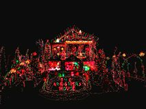 A house exterior with christmas lights decoration. A house exterior with beautiful and colorful lights decoration during christmas holiday in Torrington New stock photo