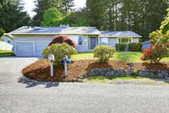 House exterior with curb appeal. House exterior with landscape on front yard. View of garage and driveway Royalty Free Stock Image
