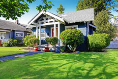 House exterior with curb appeal. Simple house exterior with tile roof. Front porch with curb appeal Royalty Free Stock Photography