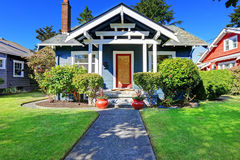 House exterior with curb appeal. Simple house exterior with tile roof. Front porch with curb appeal Stock Photo