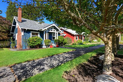 House exterior with curb appeal. Simple house exterior with tile roof. Front yard landscape and walkway Royalty Free Stock Photo