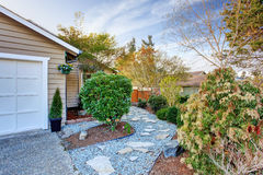 House exterior with curb appeal. House exterior with stone walkway and bushes Royalty Free Stock Photos