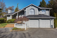 House exterior. Entance porch and garage view Stock Photography