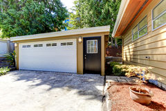 House exterior with garage and driveway Royalty Free Stock Images