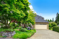 House exterior. Garage and driveway view Stock Photos