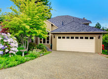 House exterior. Garage and driveway view Stock Photography