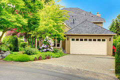 House exterior. Garage and driveway view Royalty Free Stock Photos