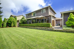 House exterior with lawn and trimmed hedges Stock Photography
