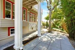 House exterior with orange trim and deck columns Stock Photos