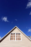 House exterior, roof close-up. Vertical. Stock Photo