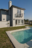 House exterior and swimming pool Royalty Free Stock Photography
