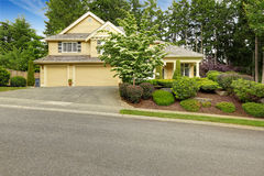 House exterior with two car garage and driveway. Beautiful landscape stock images
