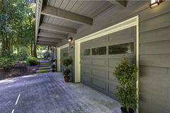 House exterior. Two car garage with driveway Royalty Free Stock Image