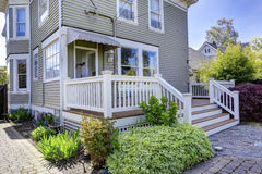 House exterior. View backyard walkout deck. House with walkout deck. View of flower bed and brick tile walkway stock photos
