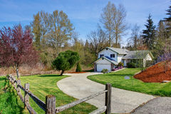 House exterior. View of driveway and front yard Royalty Free Stock Photos