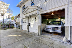 House exterior. View of garage and driveway. House exterior. Three door garage with car and driveway Stock Photos