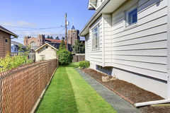 House exterior. View of side wall and green grass. Royalty Free Stock Photos