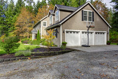 House exterior. View of three car garage with driveway and baske Stock Image