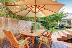 House exterior. Wooden patio table set with umbrella. Northwest, USA Royalty Free Stock Images