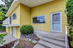 House exterior with yellow clapboard siding Royalty Free Stock Photography