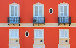 House facade. Photo of facade of red house with 3 windows royalty free stock photography