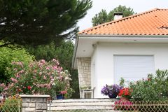 House facade. White facade  and red roof of some summer house Royalty Free Stock Images